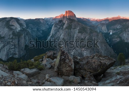 Half Dome and Yosemite Valley in Yosemite National Park during colorful sunset with trees and rocks. California, USA Sunny day in the most popular viewpoint in Yosemite. Beautiful landscape background #1450543094