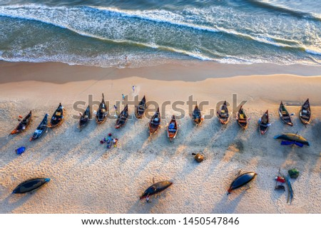 Top view or aerial view of white beach with long tail boats of fisherman in summer of tropical in Vinh Thanh, Hue, Vietnam.  #1450547846