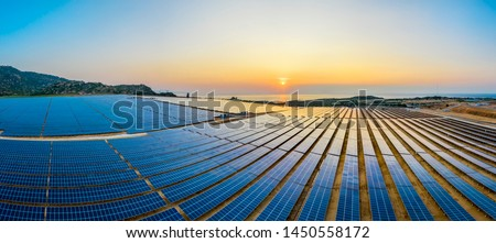 Aerial view of Solar panel, photovoltaic, alternative electricity source - concept of sustainable resources on a sunny day, Phuoc Dinh, Ninh Phuoc, Ninh Thuan, Vietnam #1450558172