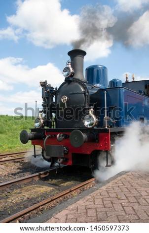 Departure of a steam tram locomotive at Medemblik, Netherlands #1450597373
