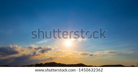 beautiful dramatic sunset among the plain silhouette, natural background panorama #1450632362