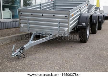 Open road trailer. Shop selling car trailers. #1450637864