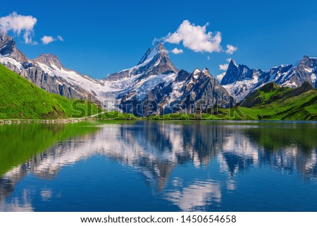 Sunset  view on Bernese range above Bachalpsee lake. Popular tourist attraction. Location place Swiss alps, Grindelwald valley, Europe.  Royalty-Free Stock Photo #1450654658
