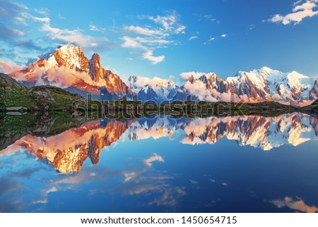 Summer sunset panorama of the Lac Blanc lake with Mont Blanc (Monte Bianco) on background, Chamonix location. Beautiful outdoor scene in Vallon de Berard Nature Reserve, France #1450654715