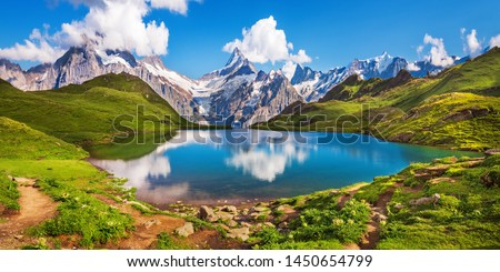 Sunrise  view on Bernese range above Bachalpsee lake. Popular tourist attraction. Location place Swiss alps, Grindelwald valley, Europe.  #1450654799