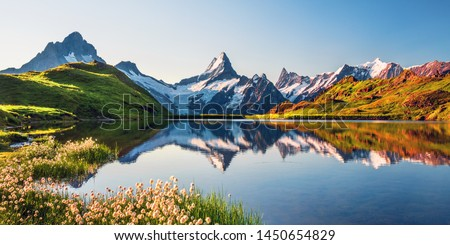 Sunrise view on Bernese range above Bachalpsee lake. Highest peaks Eiger, Jungfrau and Faulhorn in famous location. Switzerland alps, Grindelwald valley Royalty-Free Stock Photo #1450654829