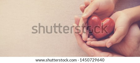 adult and child hands holding red heart, heart health and happy charity donation concept, world mental health day, world heart day, fair trade, National Organ Donor Day #1450729640