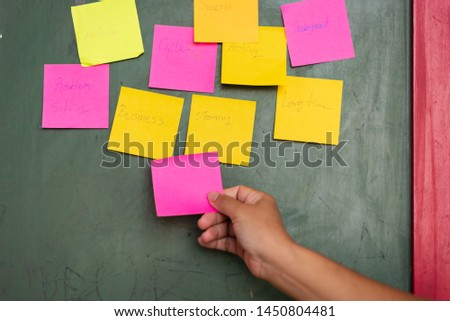 Close up business man hands holding note sticky for brainstorm and share idea strategy workshop business.Brainstorming concept. #1450804481