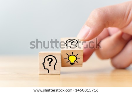 Concept creative idea and innovation. Hand flip over wooden cube block with head human symbol and light bulb icon #1450815716