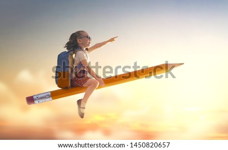 Back to school! Happy cute industrious child flying on the pencil on background of sunset sky. Concept of education and reading. The development of the imagination. #1450820657