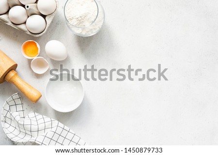 Baking Cooking Ingredients Flour Eggs Rolling Pin Butter And Kitchen Textile On Bright Grey Concrete Background. Top View Copy Space. Cookies Pie Or Cake Recipe Mockup #1450879733