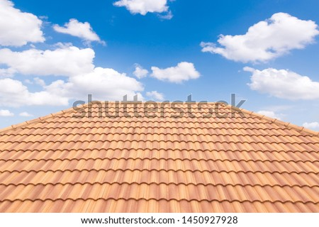 Roof tiles and sky sunlight. Roofing Contractors concept Installing House roof.  #1450927928