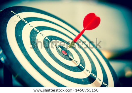 Arrow hitting in the target center of bullseye for Business focus concept, vintage style. #1450955150