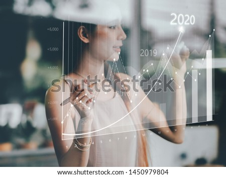 Businesswoman plan growth and increase of positive indicators in his business. Business growth concept year 2020 #1450979804