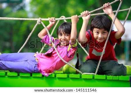 Happy asian child playing together on playground #145111546