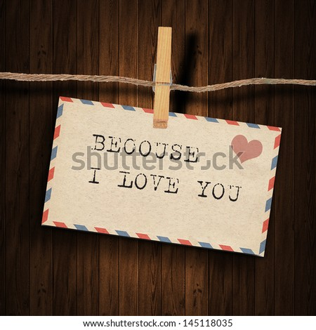 text because I love you on the old envelope and clothes peg wood background
