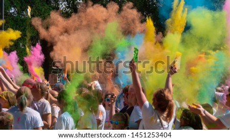 Östersund Sweden Juli 13 2019: People dancing and celebrated during the color trow. People celebrated festival of color in Sweden #1451253404