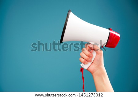 Image of hand with mouthpiece on empty blue background #1451273012