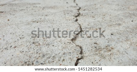 Crack in concrete. Cracked foundation. Cracked road. #1451282534