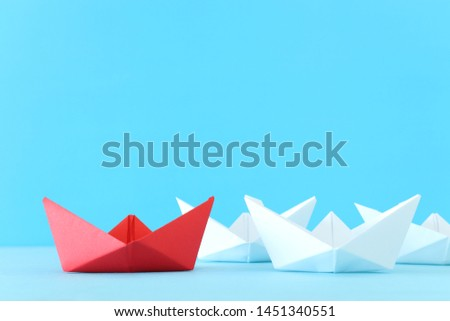 business. Leadership concept image with paper boats on blue wooden background. One leader guiding others. #1451340551