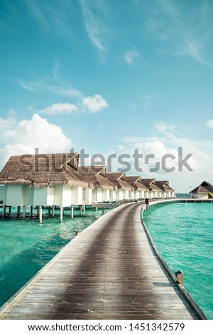tropical Maldives resort hotel and island with beach and sea for holiday vacation concept - boost up color processing style #1451342579