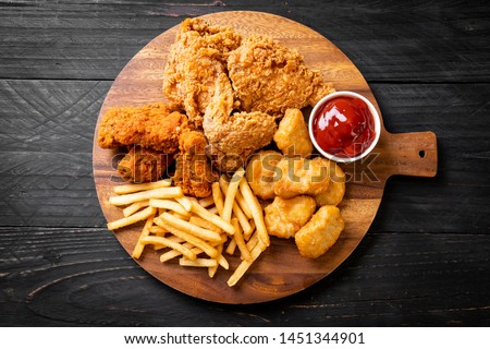 fried chicken with french fries and nuggets meal - junk food and unhealthy food #1451344901