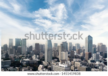 Cityscape of Tokyo city, japan. Aerial skyscraper view of office building and downtown of tokyo with sunset/ sun rise background. Tokyo is metropolis and center of new world's modern business Royalty-Free Stock Photo #1451419838