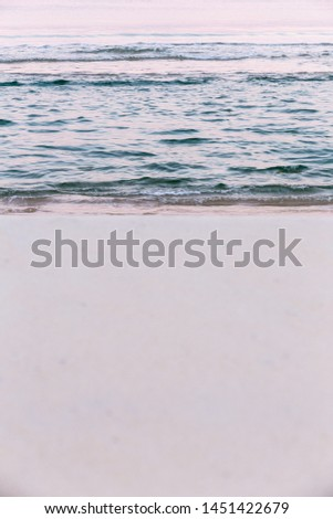 Vertical photo of a natural pink early morning light sands and waves. #1451422679