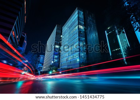 Light trails at night in urban environment Royalty-Free Stock Photo #1451434775
