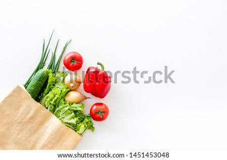 Healthy food with fresh vegetables in paper bag on white background top view space for text #1451453048