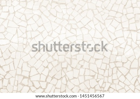 Broken tiles mosaic seamless pattern. Cream tile real wall high resolution real photo or brick seamless with texture interior background. Abstract wallpaper irregular in bathroom. #1451456567