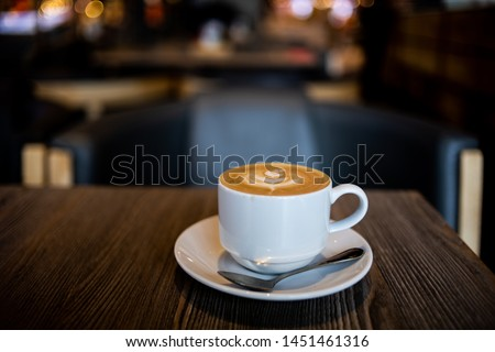 coffee latte art on the wood desk in coffee shop cafe #1451461316