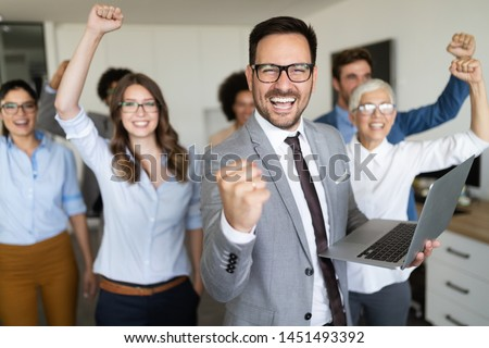Group of successful business people in office Royalty-Free Stock Photo #1451493392