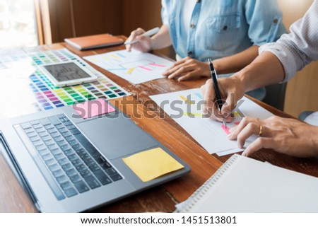 Creative UI designer teamwork meeting planning designing wireframe layout  application development mockup on smartphone screen for web mobile phone technology  #1451513801