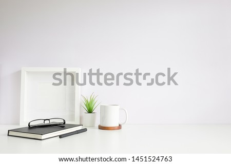 Mockup workspace desk and copy space books,plant and coffee on white desk. #1451524763