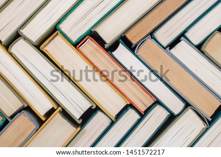 Old books and textbooks in hardcover the view from the top. Concept of education #1451572217