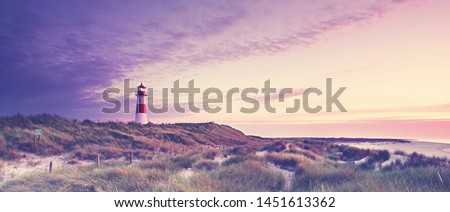 beautiful sunset in the sandy dunes on the lighthouse  #1451613362