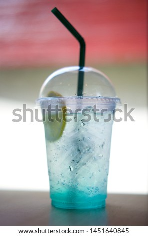 blue alcoholic cocktail in transparent glass with lemon and mint #1451640845