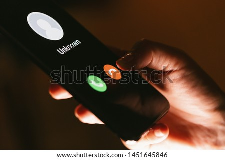 Close up of woman's hands with smartphone and unknown incoming phone call on it, fraud or scam schemes #1451645846