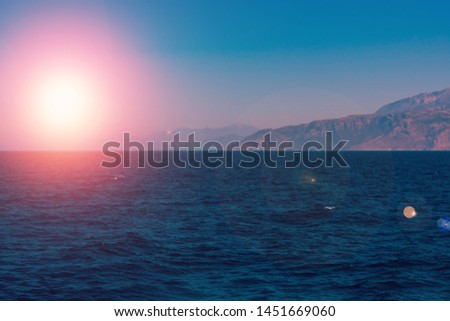 Amazing view of Mediterranean sea and mountains in mist on bright sunbeams, touristic season, summer vacation on islands #1451669060