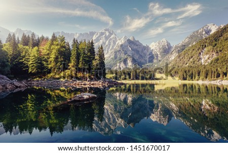 Wonderful Nature landscape. Amazing Mountains lake during sunset. Awesome alpine highlands in sunny day. Picture of wild area. Fusine lake. Italy, Julian Alps. Best travel locations.