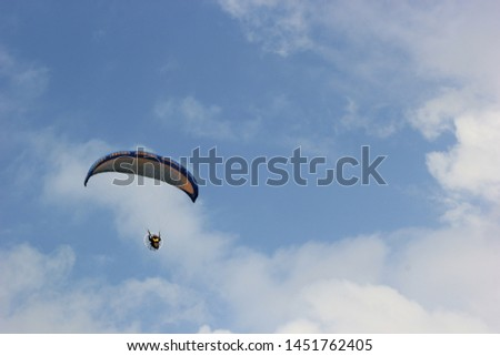 Paragliding pilots are flying over the clouds of Parangkusumo beach, Yogyakarta, Indonesia. February 17, 2018 #1451762405