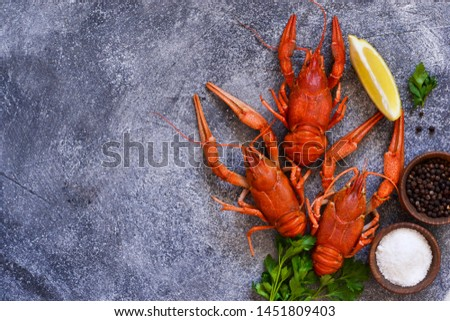 Crayfish boiled with spices on the kitchen table. View from above. #1451809403