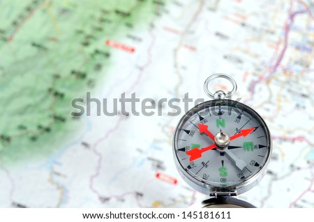 Compass photoed against the background of the map #145181611