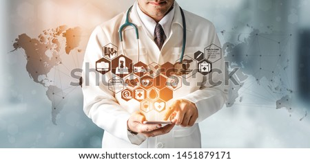 Health Insurance Concept - Doctor in hospital with health insurance related icon graphic interface showing healthcare people, money planning, risk management, medical treatment and coverage benefit. Royalty-Free Stock Photo #1451879171
