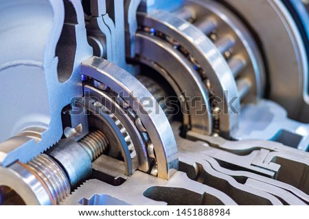 Mechanics concept. Mechanical engineering. Bearings and gears on the shaft. Box of the car transmission. Structure of a car motor. Details of the automobile gearbox. Drive engineering. Motor industry. #1451888984