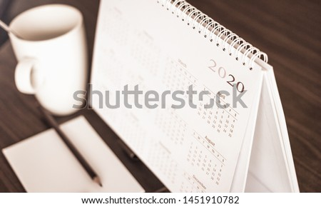 Happy new year 2020 concept: Close up calendar on desktop  #1451910782