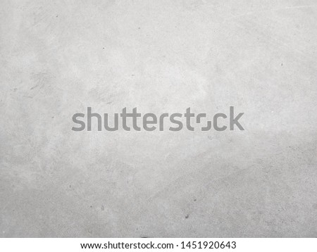 Cement wall background, not painted in vintage style for graphic design or retro wallpaper. Concrete pattern with aged texture. Loft type masonry found in rural areas. #1451920643