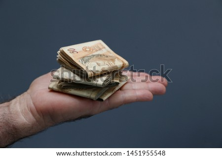 Hands holding Brazilian real notes, money from Brazil, notes of Real, Brazil BRL banknote, Brazilian currency, economy and business. #1451955548