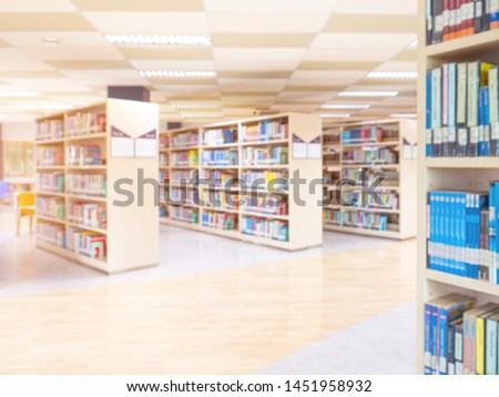 books on bookshelf in public library,  abstract blur defocused background #1451958932